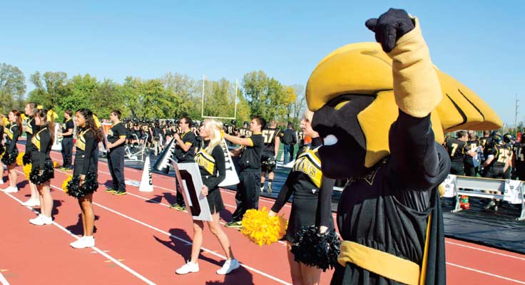 Clash, cheerleaders and students supporting UW Oshkosh athletics.